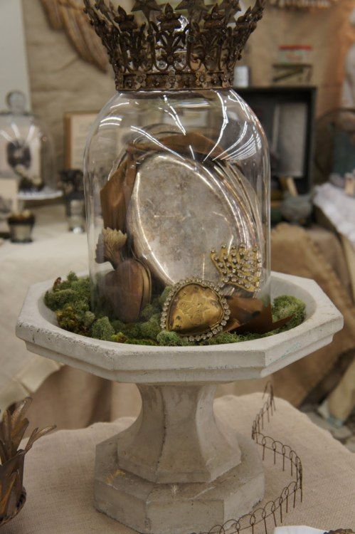 I like this display.  I am inspire to create vignettes such as this with some of my treasures and the moss that I love so much.