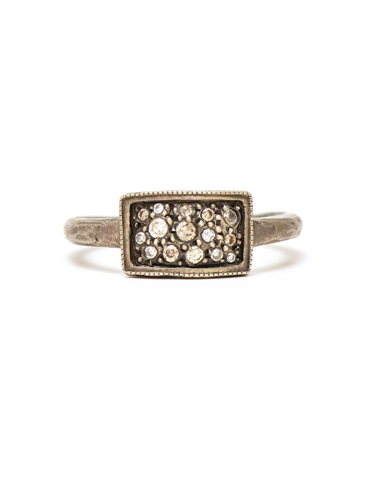 This silver and diamond ring by contemporary jeweller Suzi Zutic features a spray of 15 gems framed by an elegant silver border. Shop online securely.