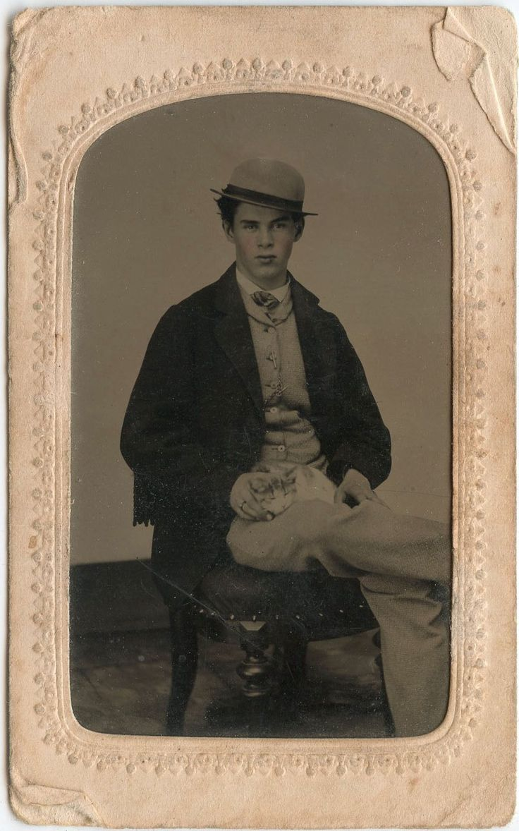 Portrait of a man and cat, 1860s.