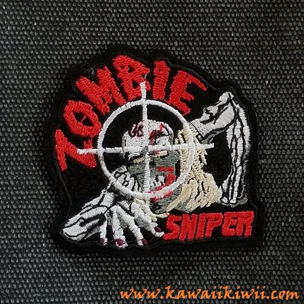 Zombie Sniper iron on patch from Kawaii Kiwii.  Have you got your zombie apocalypse survival plan? If you do, then this patch is for you!  For everyone out there that thinks zombies are as scary cool as we do!  Iron on patches, badges, pins from anime, sci-fi, fantasy, TV series, movies and more. From www.kawaiikiwii.com