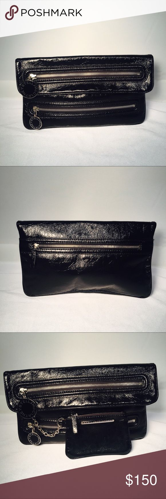 "Stella McCartney Clutch Preloved:  Black high- gloss patent leather with branded hardware, zippered pockets, and chain-linked purse for extra storage.  Measures 7"" H x 13"" W x 3"" D and in excellent condition. No documentation but authentic high quality is evident. Stella McCartney Bags Clutches & Wristlets"