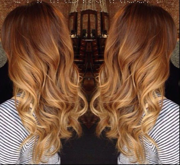 Long curly red auburn copper balayage ombre to gold caramel blonde.