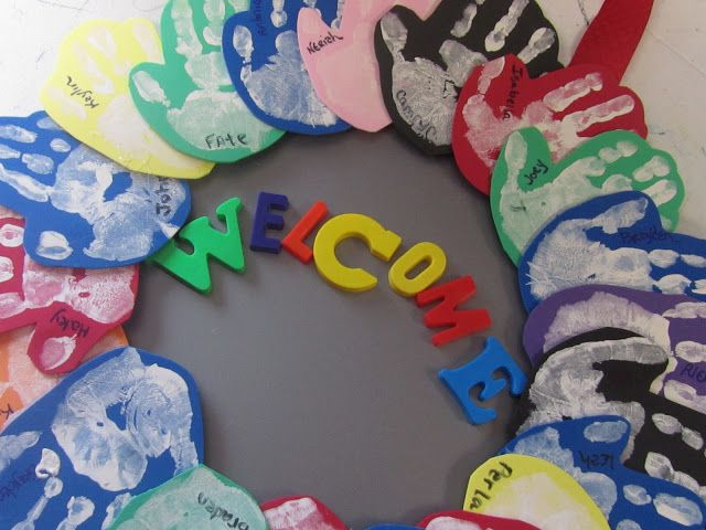 """handprint on foam hot glued on a pizza pan. (ribbon, magnet letters, paint, sharpie, foam) Could spell out """"Welcome"""" in a new language a week or ?"""