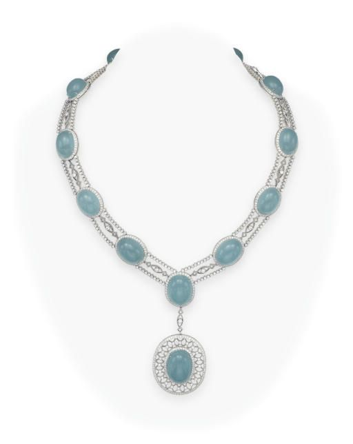 AN AQUAMARINE AND DIAMOND NECKLACE, BY TIFFANY & CO.   Suspending a pendant, set with an oval cabochon aquamarine, within a collet and circular-cut diamond surround of latticework design, to the diamond link and twin-row collet-set diamond and oval cabochon aquamarine neckband of similar design, mounted in platinum, 16½ ins., in a Tiffany & Co. black suede case  Signed Tiffany & Co., no. 19033031