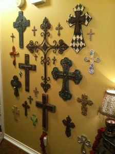 Cross Wall. My home had one growing up, and my home I raise my children in will have one.  (w/ dates and where they came from written on the back for a keepsake)