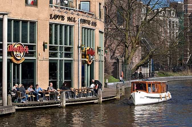 Hard Rock Cafe Amsterdam Tree Lined Canals Parks Scattered About And Bicycle Fleets All Contribute To The Wandering Hard Rock Cafe Amsterdam Tours Hard Rock