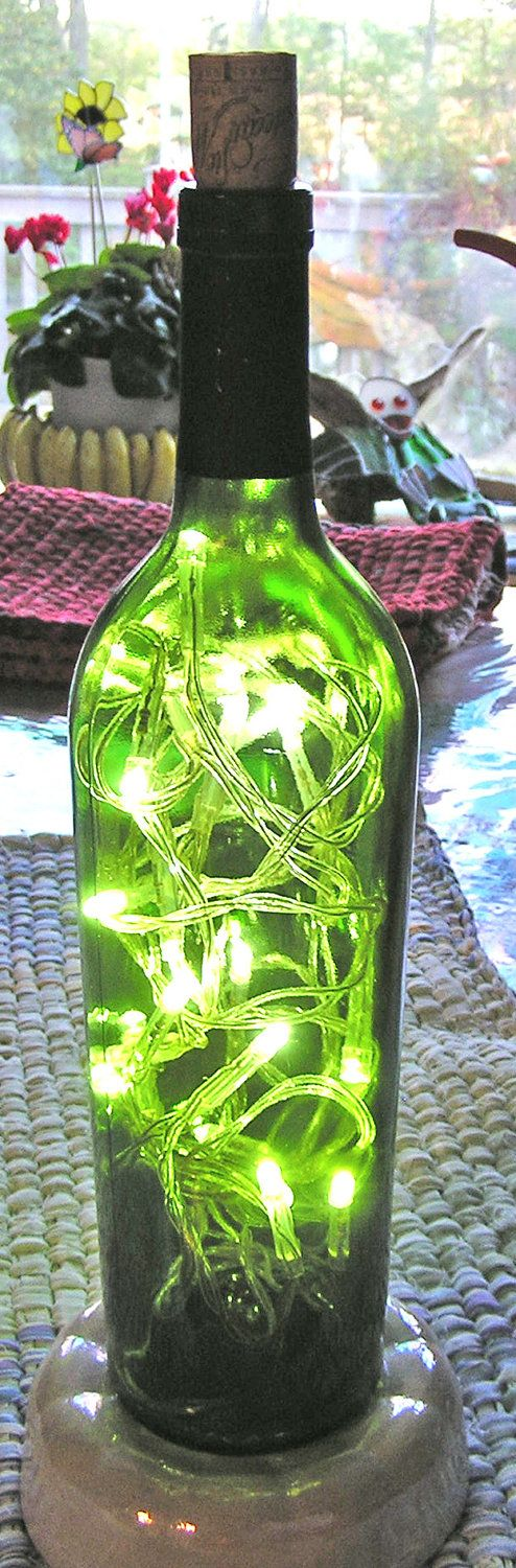Patio Lights turn bottle upside down, stuff in lights,bury in rocks in pot or whatever and plug in..cheap lighting!