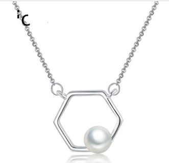 Pretty necklace with freshwater pearl in  a hexagon design.  Free Shipping