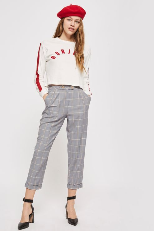 Do smart casual dressing the stylish, modern way with our tapered trousers in grey check. We're teaming them with a slogan top and on-trend pointed heels for versatile look that works for day or night.