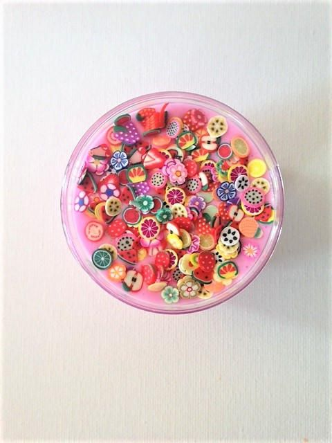 Everyone loves slime! It comes in a cute little 3 oz plastic jar with fruit confetti in PINK slime. Approx 100 pieces of fruit. **If you want an EXTRA 50 pieces the price is a $1.00 more. See picture above to see what 50 pieces looks like. Each piece is ONLY 2-3mm.** Do NOT eat or put slime near heat, or your clothes and hair, it STICKS. Slime may arrive sticky, BUT dont worry, instructions and borax will arrive with the slime so you can fix it up. If your hands are warm, rinse in cold…