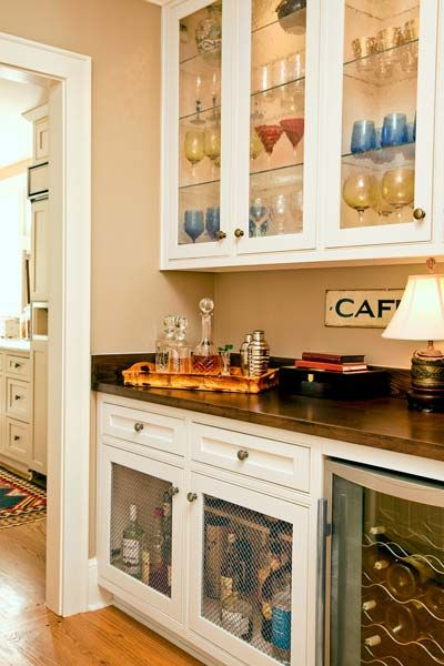 Any transitional space near a kitchen or dining room is ripe for a bar where guests can congregate before dinner is served. | Photo: Deborah Whitlaw Llewellyn | thisoldhouse.com