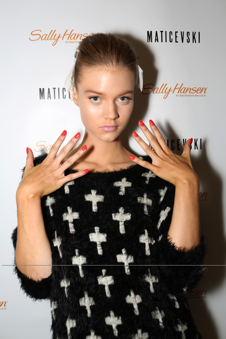 Channeling the sophistication and femininity of the 1950s, Maticevski's models sporty a rainbow of pretty Sally Hansen shades from soft purples and pastel pink to vampy red.