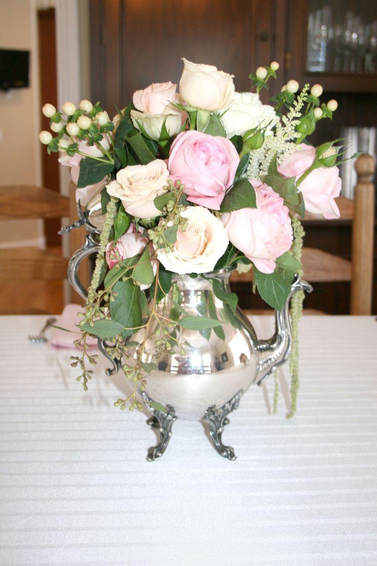Antique silver teapot centerpiece arrangements: Roses, White Gloria Astilbe, Hanging Amaranths, Garden Roses, Hydrangea, Hypericum Coral Berries, Jasmine White Roses, Eucalyptus