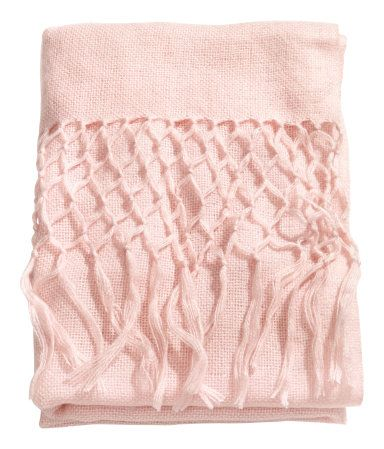 Throw in a soft, loosely woven fabric with long fringe at short sides. Size 51 x 67 in.