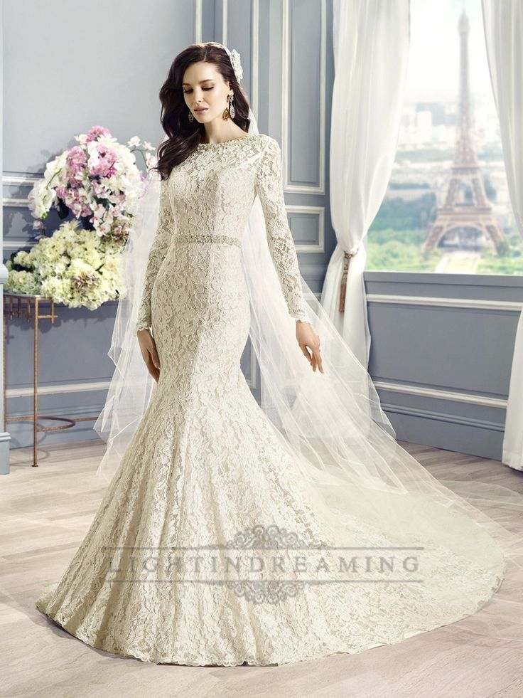 Alencon lace embellishes this romantic mermaid gown with a bateau neckline that transitions into long sleeves.