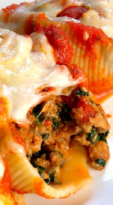 Classic Stuffed Shells with Italian Sausage, Ground Beef, Spinach, Garlic and Herbs, Stuffed in Jumbo Shells, Then Topped with Sauce and Cheese.
