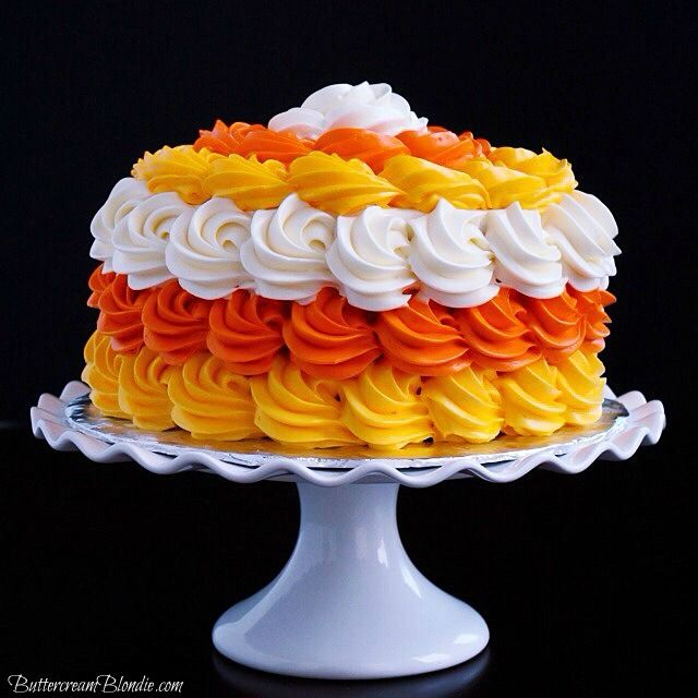 Candy Corn Halloween Cake - This cake has a lot of buttercream and I love how it looks so lush and festive!