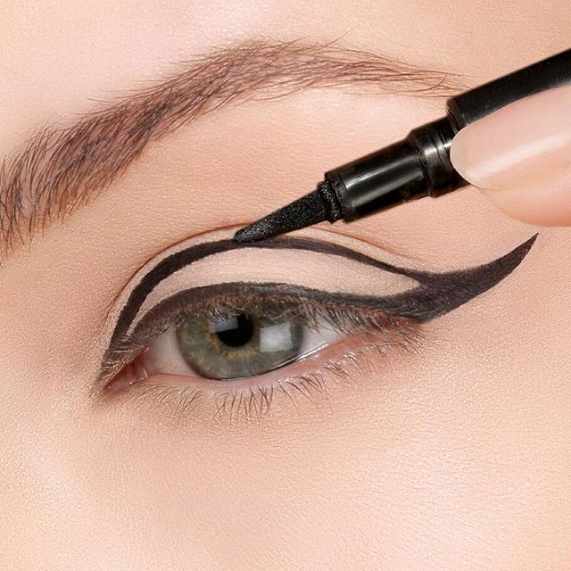 To achieve a dramatic eye use the #ThinLizzy Precision Liquid Eyeliner. First trace the outline of the wing, then fill in to keep an even line #beautytips #perfect #wingedeyeliner #bblogger #thinlizzybeauty