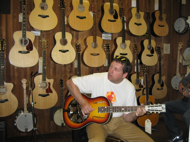 Trying out the large selection of stringed things @ McCabes Guitars , Santa Monica