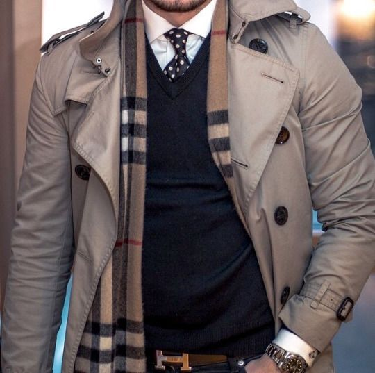 Trenchcoat layered over jumper/shirt combo. Burberry scarf and Hermes belt elevate the look.