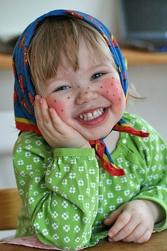 Swedish Easter Witch!  - In order to look as a real påskkärring children also have their face painted with big red cheeks, some lipstick and painted freckles.