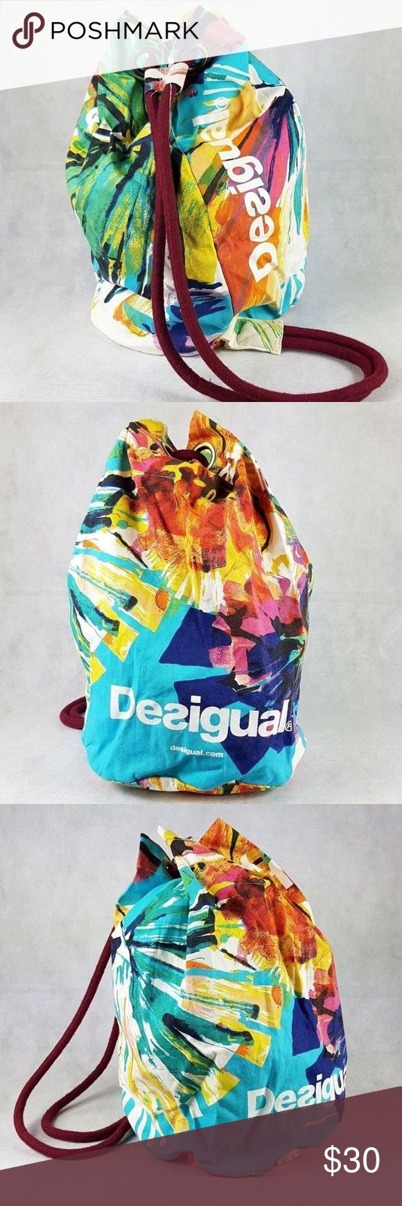 """[Desigual] large beach tote rucksack backpack bag [Desigual] large beach tote rucksack backpack bag. Excellent condition. Used once only. it will fit your beach towel, your sunscreen, your water bottle, your snacks and more. Beautiful typical Desigual abstract print. Vibrant colors. Drawstring is thick, which makes the bag durable and easy to carry even if it full with heavy items. Bag height about 19"""". Bottom width about 12"""". 100% Cotton material Desigual Bags Backpacks"""