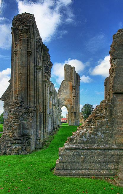 Glastonbury Abbey was a monastery in Glastonbury, Somerset, England. The ruins are now a grade I listed building, and a Scheduled Ancient Monument and are open as a visitor attraction.