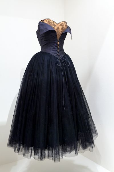Black tulle and satin dress with brocade, and bat influence.  Costume Design by Adrian