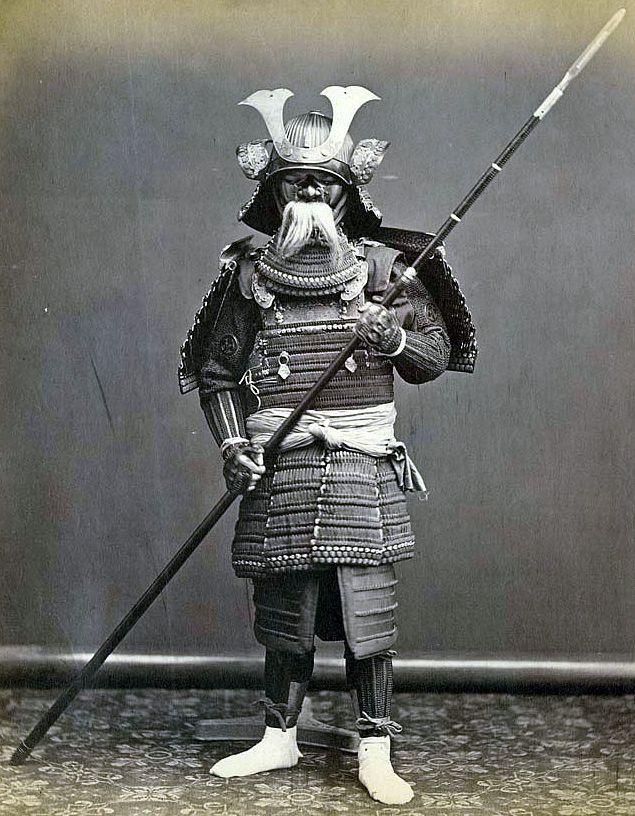 Samurai Wearing Armor And Holding A Yari Spear