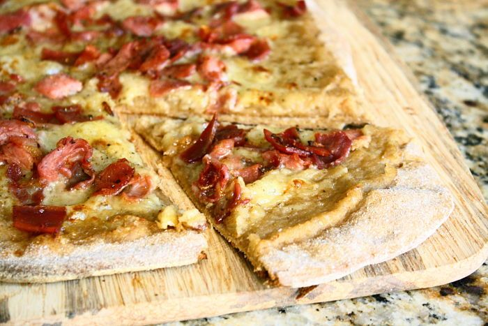 A restaurant-style gourmet pizza with gruyere, crispy prosciutto and caramelized onion puree that takes less than 40 mins to make and costs under $10. Hallelujah