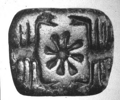 Inanna's symbol is the eight-pointed star or rosette, appearing between the pincers of two scorpions on the square face of this stamp seal. Dated c.3300 B.C. North Mesopotamia.