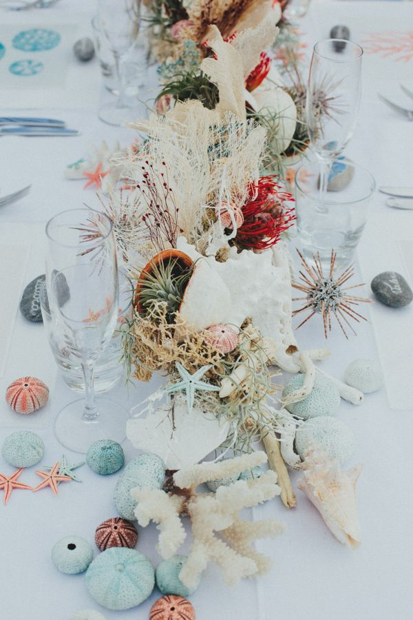 beach wedding tablescape, photo by IglooPhoto http://ruffledblog.com/wedding-inspiration-on-an-italian-sailing-ship #weddingideas #beachwedding