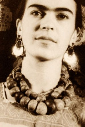 Frida Kahlo...a woman before her times.  If you don't know...you need to know.  A Mexican artist...a true Woman..married to Artist Diego Rivera.  I first saw her artwork in 1997 and ever since then...I have been in love with her work, her struggle..and her life story.