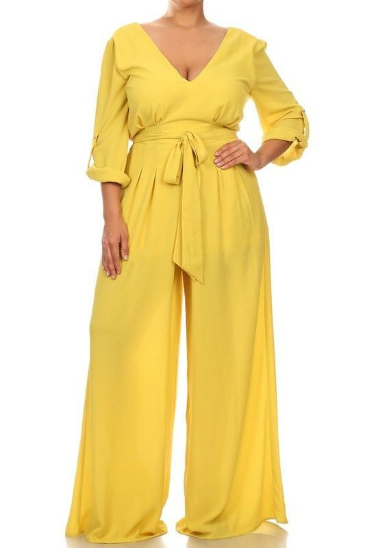 Plus size solid 3/4 roll-up sleeve relaxed fit wide leg jumpsuit with v-neck, waist tie, and low back.