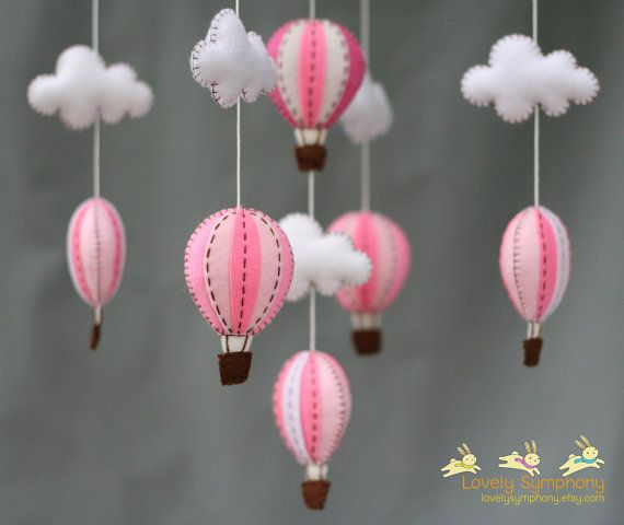 Omg, NEED these for Alice's bedroom when we set it up soon. Pink hot air balloons baby mobile