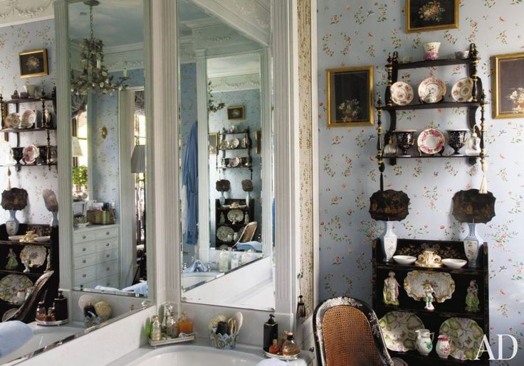 TRADITIONAL BATHROOM BY FRIEDERIKE KEMP BIGGS  In the master bath of her New York penthouse, Friederike Kemp Biggs worked with architect George W. Sweeney to maximize the room's storage capabilities, then used a Scalamandre wallpaper to match the company's silks in the adjoining bedroom. Chinoiserie shelving displays porcelain.