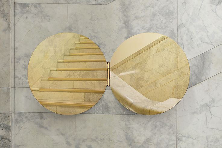 hinged brass mirror by morie nishimura