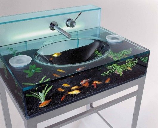 Fish tank sink. Cool idea but I would imagine using the hot water would require new fish each time...