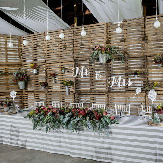 Rustic Barn Wedding Backdrop Ideas: Reclaimed Wooden Pallets Make A Unique Rustic Backdrop At