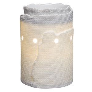 A raw-edged burlap texture enwraps a pristine porcelain warmer that glows with ethereal golden light. To purchase, go to www.jenni.scentsy.com.au