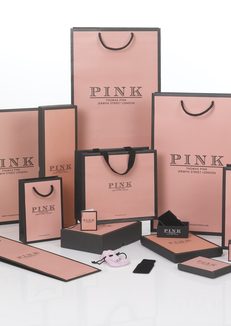 Thomas Pink Luxury Packaging Range . An ever increasing range of packaging including carrier bags, pochettes, rigid boxes, suitcovers, tissue, ribbon, stickers, draw string boxes and other seasonal additions all printed in Thomas Pink 'pink'!