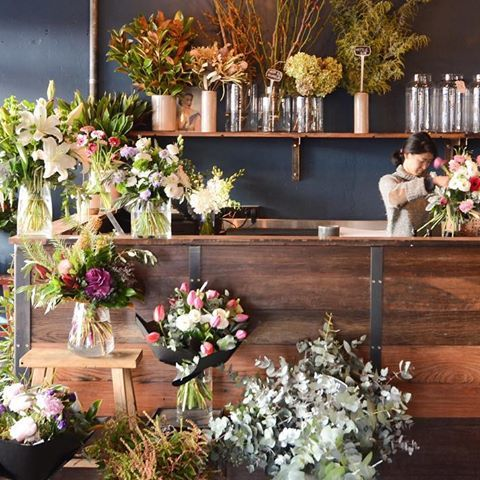Winter light flooding the florist. Our counter is made from glorious reclaimed wood, providing a neutal (and natural) backdrop for the true stars - our flowers!