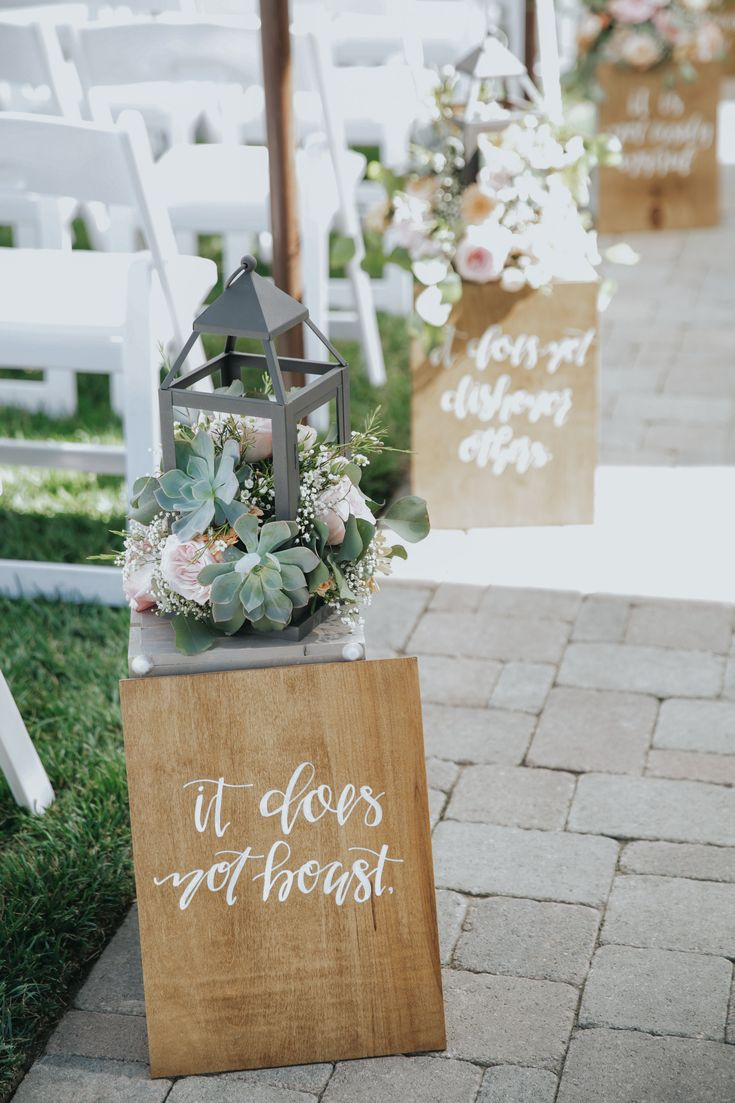 Wedding Ceremony Aisle Floral Arrangements. Gerbera Daises, Blush Roses, Babies Breath, Succulents and Wax Flower in Lanterns. Jenny Smith & Co.