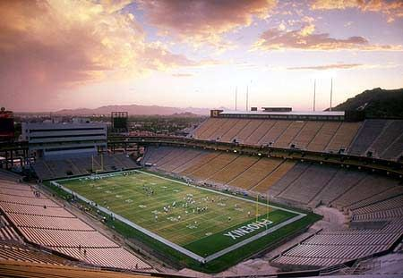 Sun Devil Stadium - Tempe, Arizona.  My grandfather helped wire up (electrical) the original part, then my dad worked on the new (1980's) addition as a crane operator for Tanner Brothers.