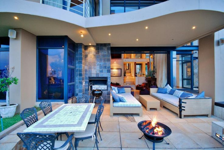 Breathtaking ...  Hugging the cliff high up on the hill sits a home of distinction with splendid views, gorgeous heated infinity pool and marvelous entertainment areas. The triple volume living room leads out to the covered patio and built in braai. #northcliff #johannesburg #pamgolding