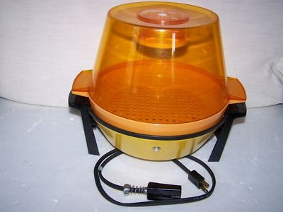 This made the best popcorn EVER! You put butter in the holder on top, and the heat of the popper melted it so that it buttered the popcorn as it popped. I still have a scar from the hot oil leaking out when flipping it over!