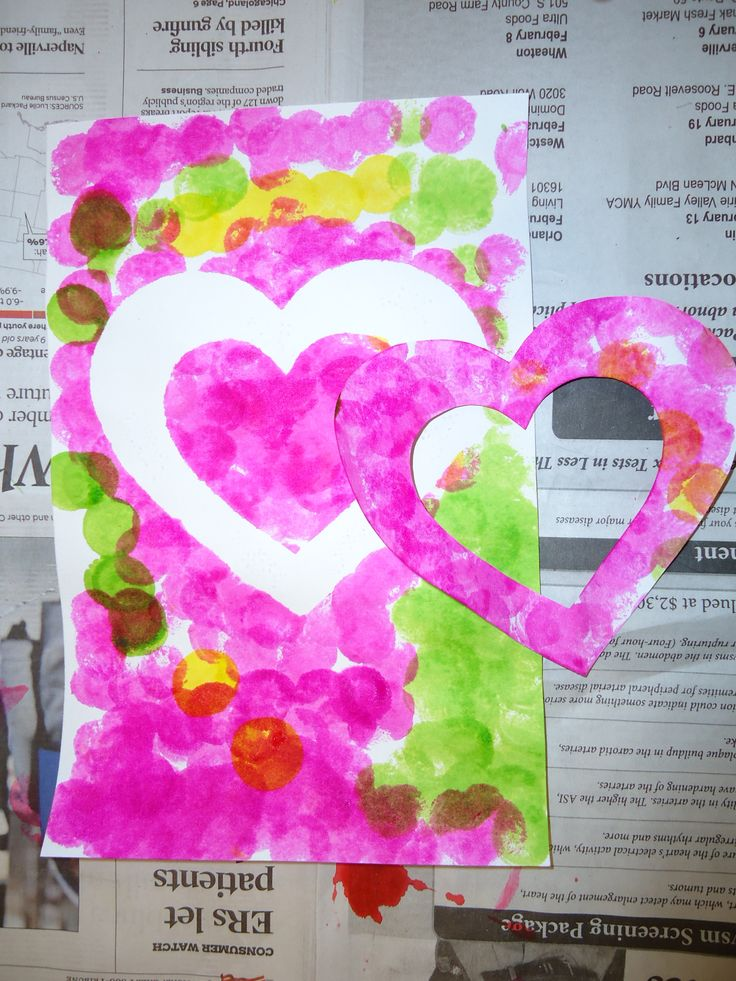 We are making a special Valentine in the Maple Room. The teachers cut out a heart shape and tape it to the front of a white paper. The children us dab a dot painters to paint all over the paper. Then we remove the heart to reveal the negative heart shape. We add both to the finished card.