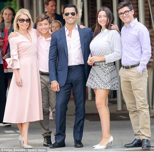 Pretty in pink! Kelly Ripa cut a chic figure on Sunday in New York City alongside her family