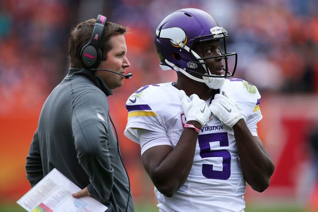 Denver Broncos narrowly take down Minnesota Vikings - Gallery - TheDenverChannel.com - DENVER, CO - OCTOBER 4: Quarterback Teddy Bridgewater #5 of the Minnesota Vikings looks on with a member of the coaching staff during a game against the Denver Broncos at Sports Authority Field at Mile High on October 4, 2015 in Denver, Colorado. (Photo by Doug Pensinger/Getty Images)