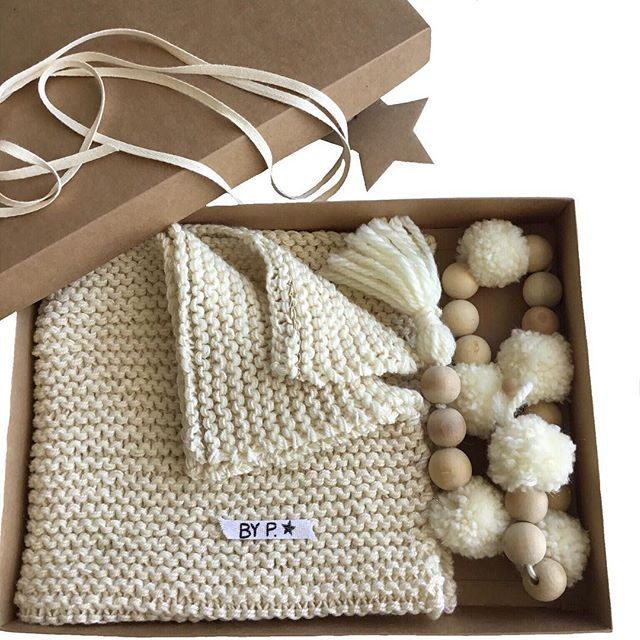 This is My box which includes : - a lovely soft baby blanket - a pompom garlandwith wooden beads  All in a kraft box ready to be offered #babygift #byppenelope #capetown #lovecapetown #southafrica #knit #blanket #garland #knitting #gift